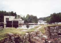 �mm�koski hydroelectric power plant located on the south side of �mm�koski rapid. Castle ruins in the front.